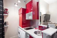 1-bedroom Paris luxury apartment with equipped kitchen in red hue