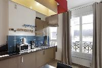nice kitchen with balcony at Marais - Saint Claude luxury apartment