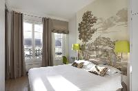 awesome bedroom accents in Marais - Saint Claude luxury apartment