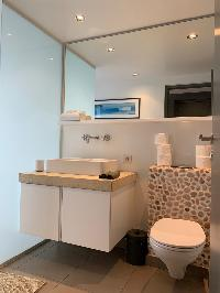 clean toilet and bath in Saint Barth Villa Roche Brune luxury holiday home, vacation rental