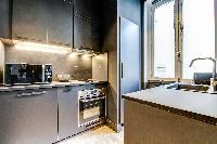 modern kitchen of Champs Elysées - Foch - 1 Bedroom luxury apartment