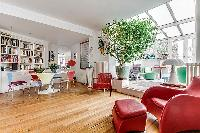 colorfully designed living area and dining area in a 2-bedroom Paris luxury apartment