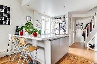 sleek breakfast bar and stools in a Paris luxury apartment