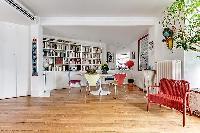 2 bedroom Paris luxury apartment with its original hardwood floors, open floor concept, and mid-cent