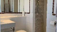 clean toilet and bath in Saint Barth Villa Lagon Rose luxury holiday home, vacation rental