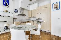 modern kitchen and dining area in a 2-bedroom Paris luxury apartment