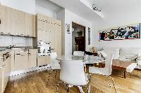 lovely dining area, kitchen and living area in a 2-bedroom Paris luxury apartment
