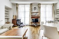 lovely dining area and living area with double-glazed windows in a 2-bedroom Paris luxury apartment