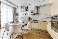lovely kitchen and dining area with double-glazed windows in a 2-bedroom Paris luxury apartment