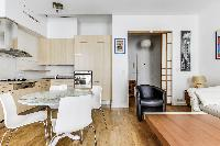 lovely dining area, living area and kitchen in a 2-bedroom Paris luxury apartment