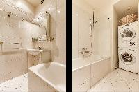 modern bathroom with bathtub, shower, sink, washer and dryer in a 2-bedroom Paris luxury apartment
