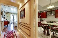 hallway and spacious fully-equipped kitchen with built-in wooden cupboards in a 3-bedroom Paris luxu