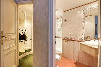 en-suite bathroom with a toilet, a bidet, a sink, and a shower area in a 3-bedroom Paris luxury apar