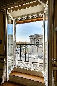 splendid views of the Louvre, the Seine River, the Invalides, and the Eiffel Tower in a 3-bedroom Pa