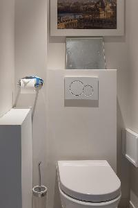 neat and trim toilet and bath in Eiffel Tower - Avenue de la Motte-Picquet luxury apartment