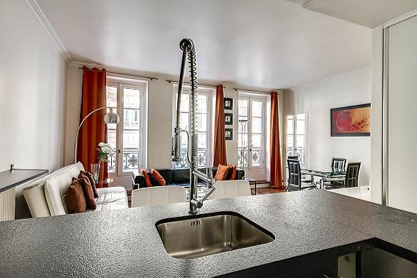 modern and space-efficient kitchen in a 2-bedroom Paris luxury apartment