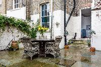 cool patio with garden chairs at London - Ebury Street luxury apartment