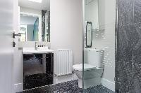 spic-and-span toilet and bath in Kensington Church Street VIII luxury apartment