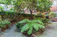 lush garden of Kensington Church Street VIII luxury apartment