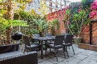 pretty patio and garden of Kensington Church Street VIII luxury apartment
