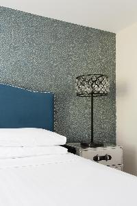 crisp bed sheets in Kensington Church Street VIII luxury apartment