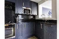 modern kitchen appliances in Kensington Church Street VIII luxury apartment