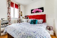 brand-new queen-size bed in the Master bedroom of a 2-bedroom Paris apartment