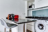 breakfast bar and modern kitchen in a studio Parisian apartment