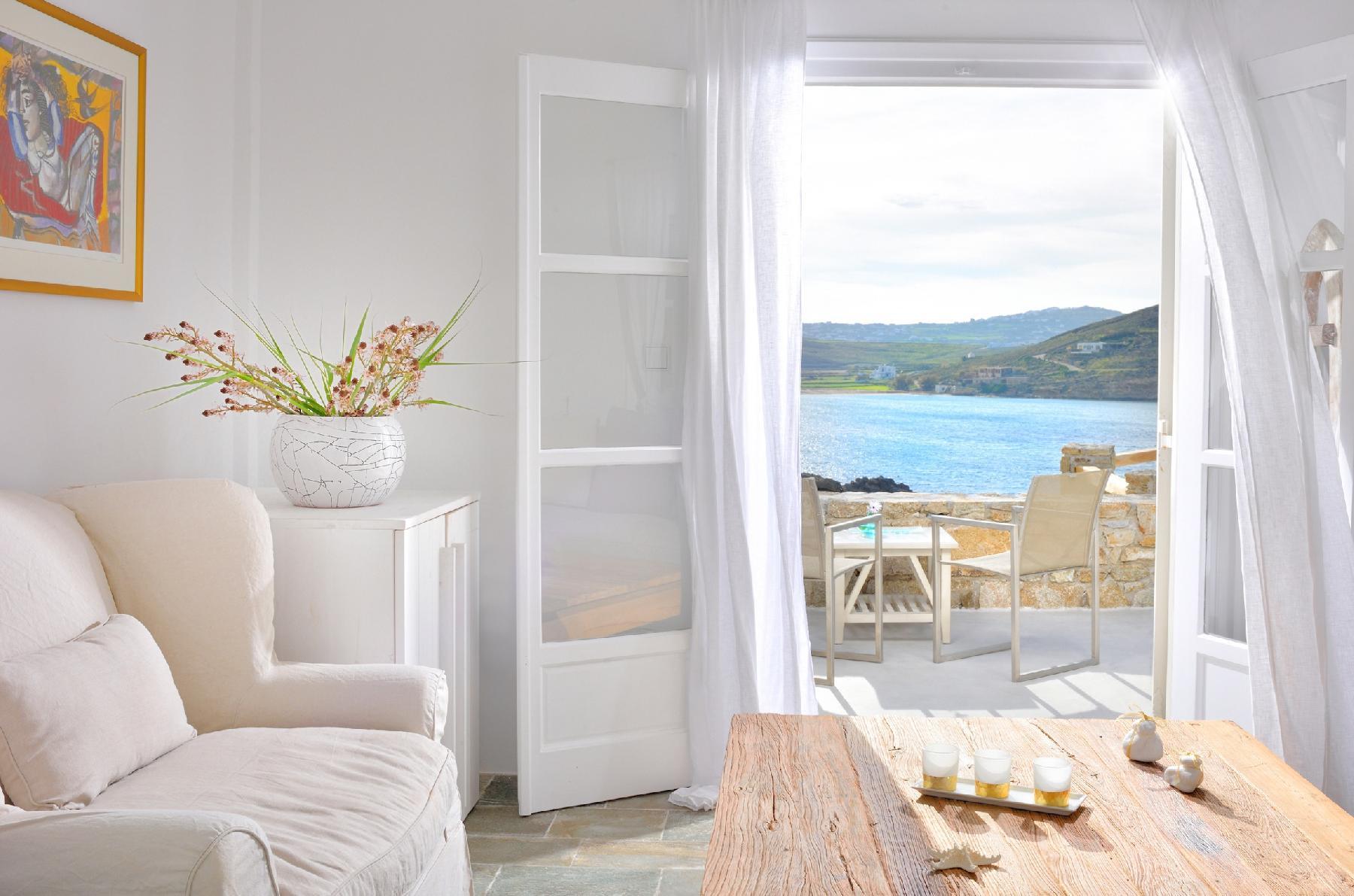 Villa Juliet, beautiful beachfront villa in Mykonos with amazing sunset view by Elite Estates.