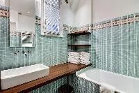 cool bathroom with tub in Saint Germain des Prés - Bonaparte luxury apartment