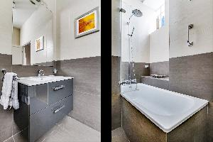 cool rain shower and tub in Marais - Francs Bourgeois luxury apartment