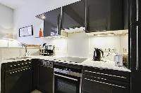 sleek kitchen of Saint Germain des Prés - Dragon I luxury apartment