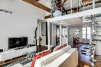 modern living area, dining area, kitchen, bedroom, and bathroom in a 1-bedroom loft Paris luxury apa