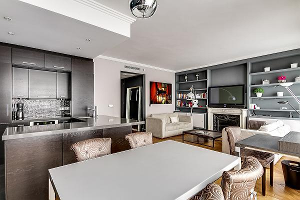 modern elegantly decorated living area, a dining area, a kitchen, two bathrooms, and two bedrooms pa