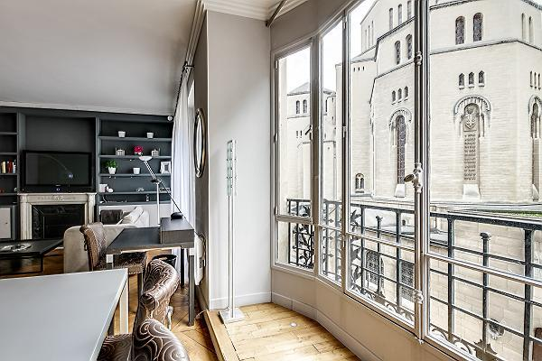 tall French windows overlooking the city in a 2-bedroom paris luxury apartment