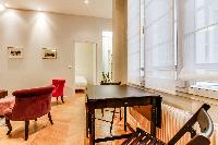 mini dining area for 2 with wooden table and chairs in Paris luxury apartment