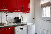 red and white kitchen in a 3-bedroom Paris luxury apartment