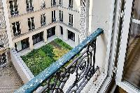 relaxing inner courtyard in a 3-bedroom Paris luxury apartment