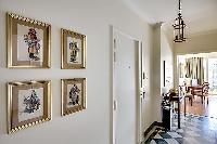 work of arts hanging on the white wall in Paris luxury apartment