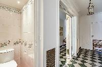 A water closet beside the bathroom with a toilet and a sink in Paris luxury apartment