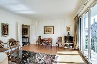 living area illuminated by the French windows that line the sides, giving the room a fresh and vibra