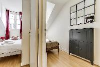 second and third bedrooms in a 3-bedroom Paris luxury apartment