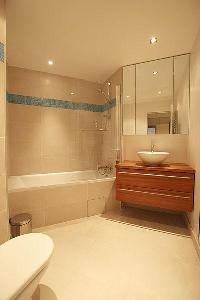 elegant bathroom with tub in Passy La Tour luxury apartment