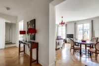 dining area with a round table and four chairs in a 2-bedroom Paris luxury apartment