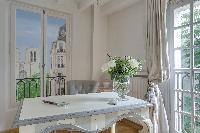 delightful dining room of Notre Dame - Colbert Suite luxury apartment