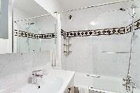clean bathroom with tub in Saint Germain des Prés - Luxembourg Suite luxury apartment