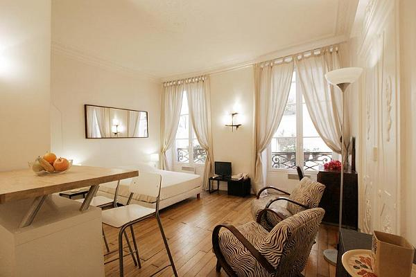 cozy living area, the sleeping area, the dining area, and kitchen in a 1-bedroom Paris luxury apartm