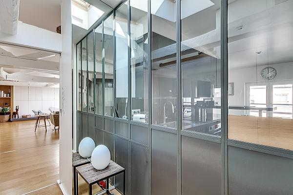 spacious and monochromatic kitchen in Paris luxury apartment