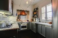 well-equipped kitchen in a 3-bedroom Paris luxury apartment