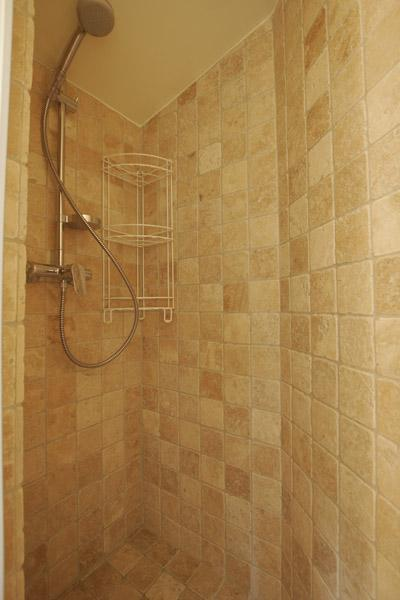 bathroom with shower in a 2-bedroom Paris luxury apartment